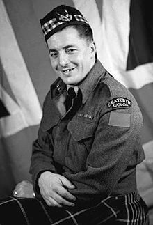Victoria Cross Recipient Ernest Smith posing for photo
