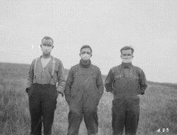3 men wearing masks because of The Spanish Flu