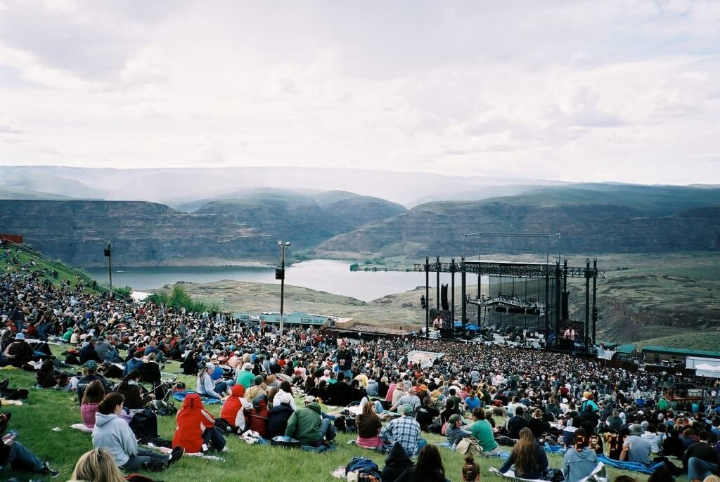 Fans sitting on a hill at The Sasquatch Music Festival.